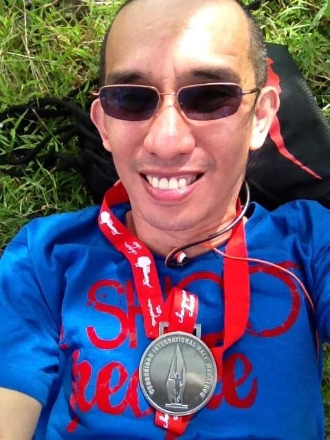 Proudly showing my Corregidor International Half-Marathon 21K finisher medal